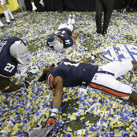 Football players celebrating championship