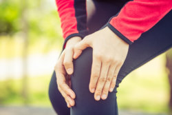 collagen joint woman holding knee